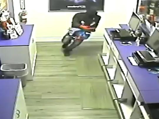 Police are looking for four burglars who broke into a Metro PCS in Titusville in December.