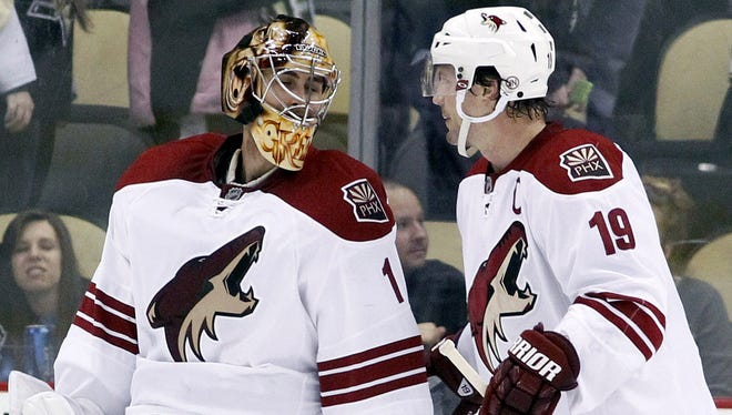 Phoenix Coyotes goalie Thomas Greiss and captain Shane Doan celebrate Tuesday's win against the Pittsburgh Penguins.