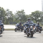 In honor of the Michigan State Trooper killed in the line of duty, members of the Indiana State Police parked their vehicles the parking lot of the Hartland Educational Support Service Center, and unloaded their motorcycles from trailers to proceed to his funeral.