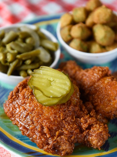 Green beans, fried okra and spicy hot chicken are on