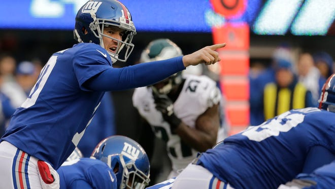 New York Giants quarterback Eli Manning (10) gestures before the snap against the Philadelphia Eagles during the second half of an NFL football game Sunday, Dec. 17, 2017, in East Rutherford, N.J.