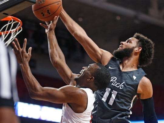 Caleb Martin blocks the shot of Texas Tech's Keenan Evans. Martin is the best college defensive player Eric Musselman has seen live, the coach said.