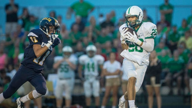 New Castle's Luke Bumbalough gets behind the Delta defense on Sept. 22 at Delta High School. Delta won the game 56-49.
