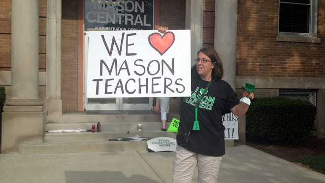About 300 Mason teachers and supporters gathered in front of the Mason City Schools' administrative offices on July 8 to support the union's ongoing contract negotiations with the school board.