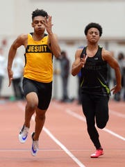 McQuaid's Noah Williams, left, out kicks Rush-Henrietta's Anthony Brinson to win the Class A 55 meter dash with a time of 6.46 during Section V Class A/B Winter Track & Field Championships at RIT on Feb. 16, 2017.