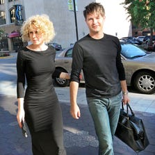 Indianapolis Symphony Orchestra music director Krzysztof Urbanski and his wife, Joanna, walk to the musician's entrance of Hilbert Circle Theatre for the opening concert of the 2014-15 season on Sept. 14.