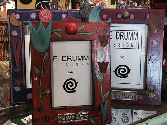 Photo frames by E. Drumm.