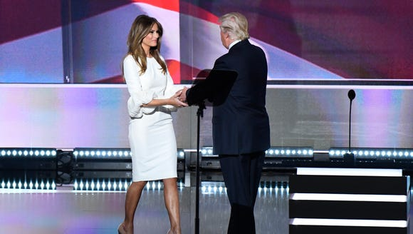 Donald Trump greets his wife, Melania Trump, on stage