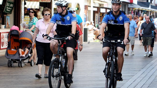 In this file photo, seasonal Ocean City police officer Bernie Wawzyanick (left) patrols the boardwalk near the inlet with fellow Officer Dylan Kull. Returning seasonal Ocean City police officer Bernie Wawzyanick of Wantage, NJ, left, patrols the boardwalk near the inlet with fellow Officer Dylan Kull of Glen Mills, PA. Kull is in his first year of duty with the town's department.