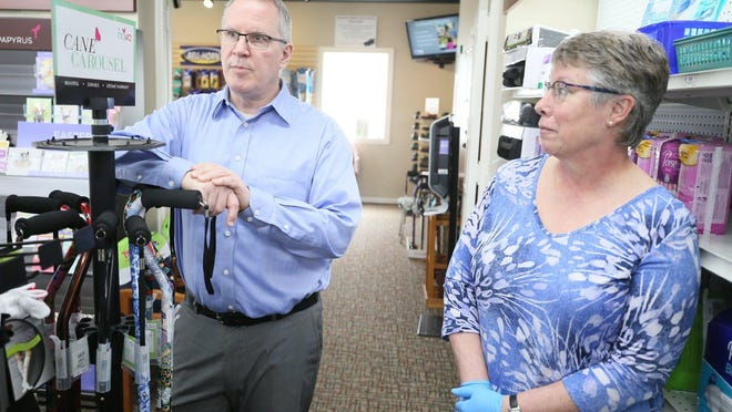 Tom and Peg Lamb, pharmacists and owners of Sand Run Pharmacy.