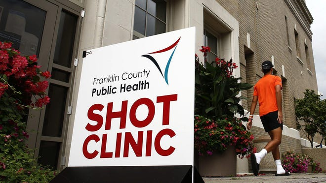 Emad Kate, 17, of Dublin, leaves after getting a Meningitis B vaccine on Sept. 2 at Franklin County Public Health. Starting in October, the agency will offer flu shots.