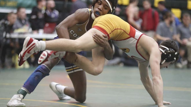Copley's Kyren Butler, left, wrestles Brecksville's Devin Miller in early rounds during the Bill Dies Memorial Tournament in January.