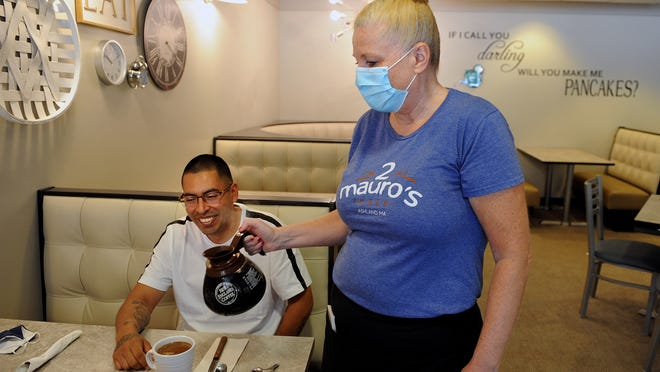 2 Mauro's Cafe's Susan Bianco refills the coffee for customer Christhian Oros, of Marlborough, Wednesday, June 24.