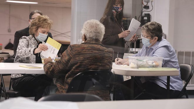 Poll workers prepare to count provisional and military ballots at the Board of Elections warehouse on November 7, 2020 in Augusta, Ga. Monday, Richmond County Board of Elections approved 140 provisional ballots cast in the Jan. 5 runoffs for U.S. Senate.