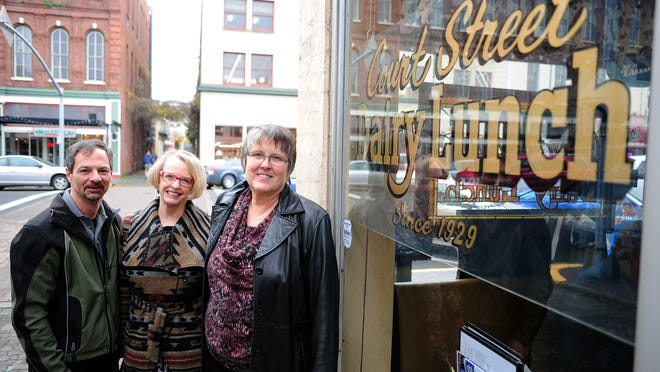 Paul F. Peloquin, from left, Carolyn Schnoor and Sonia E. Hoyt, board members of Shelly's House Inc., a non-profit providing safe, drug-free housing for women offenders at risk of homelessness in Marion County, during Holding Court at Court Street Dairy Lunch on Tuesday, Dec. 23, 2014, in Salem.
