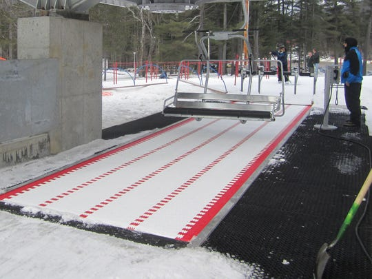 An example of the new four-person chairlift with a loading conveyor that will open at Arizona Snowbowl this year.