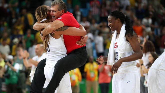 USA center Brittney Griner (15) celebrates with USA head coach Geno Auriemma (USA) in the women's basketball gold medal match during the Rio 2016 Summer Olympic Games at Carioca Arena 1.