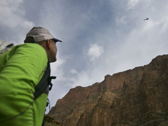 Grand Canyon explorer and activist Rich Rudow watches a helicopter fly over the western part of Grand Canyon National Park.