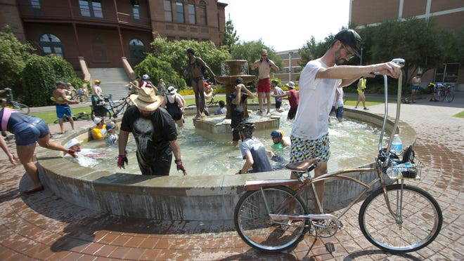 Members of the Tempe Bicycle Action Group and their supporters will celebrate the hottest time of the year with the Summer Solstice Ride through Tempe on Saturday, Sept. 27. A few cool-down stops like this one may also be necessary.