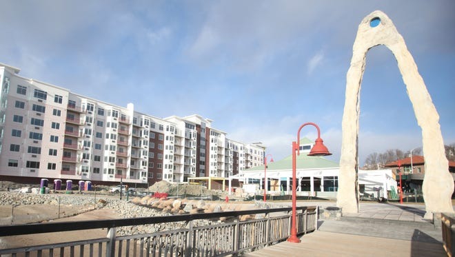 The view from the pier shows Harbor Square in Ossining, the art installation (right) and the soon-to-open restaurant.