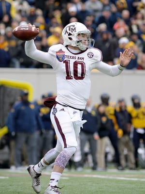 Dec 29, 2014; Memphis, TN, USA; Texas A&M Aggies quarterback Kyle Allen (10) during the game against the West Virginia Mountaineers in the 2014 Liberty Bowl at Liberty Bowl Memorial Stadium. Mandatory Credit: Justin Ford-USA TODAY Sports