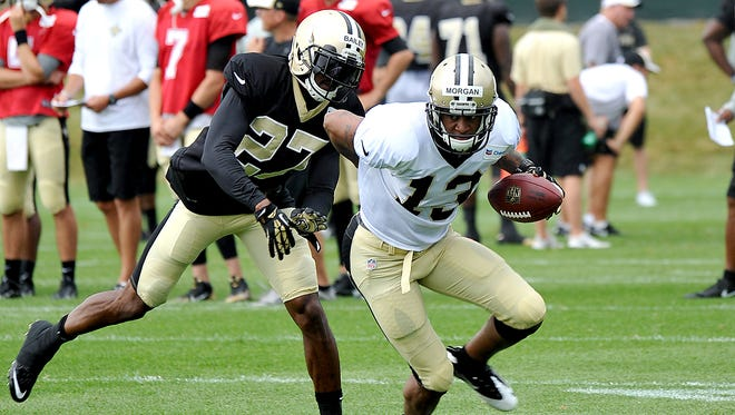New Orleans Saints wide receiver Joe Morgan (13) runs ball with New Orleans Saints cornerback Champ Bailey (27) trying to make the tackle during there NFL football training camp in White Sulphur Springs , W. Va., on Sunday.