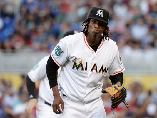 Miami Marlins starting pitcher Jose Urena walks to the dugout after pitching in the first inning of a baseball game against the Boston Red Sox, Tuesday, April 3, 2018, in Miami. (AP Photo/Lynne Sladky)