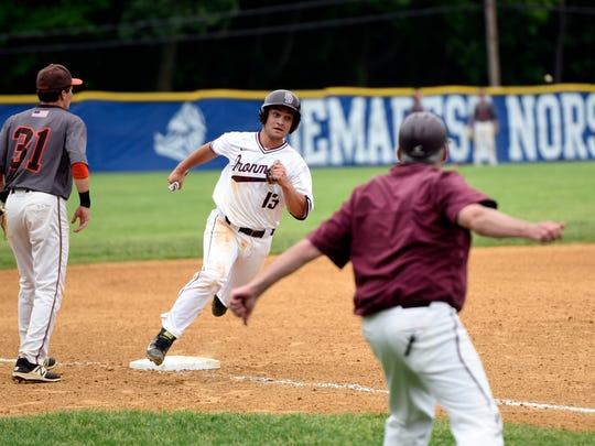 Don Bosco's Armando Alvarez (13) rounds third base