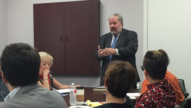 Attorney Dan Huffstutter explains his research into Two Rivers Company to board members during a Wednesday meeting.