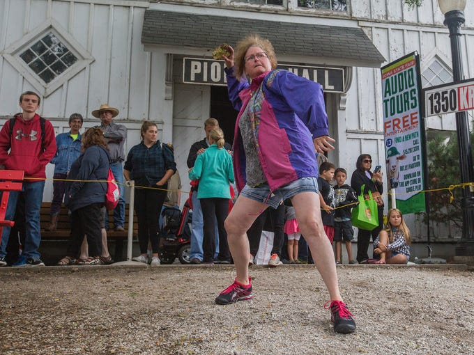 Becky Martin of Blakesburg throws at the KRNT Cow Chip