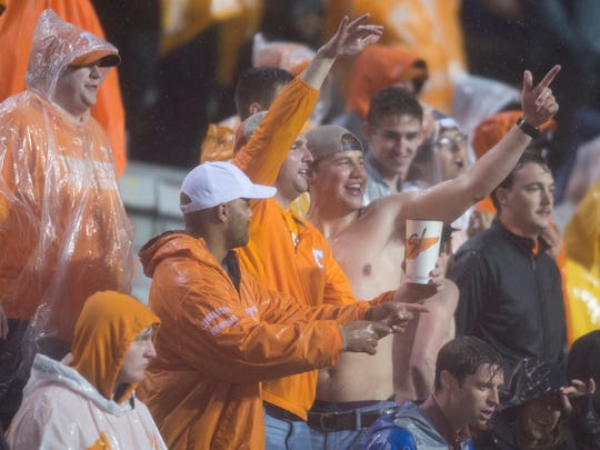 Fans dance in the heavy rain during a game between Tennessee and LSU at Neyland Stadium in Knoxville, Tennessee, on Saturday, Nov. 18, 2017.
