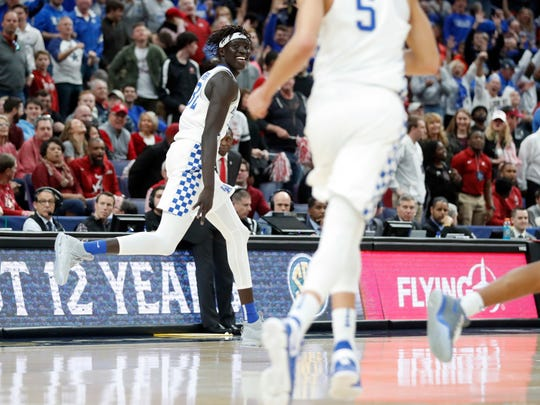 Kentucky's Wenyen Gabriel celebrates during the second half of an NCAA college basketball semifinal game against Alabama at the Southeastern Conference tournament Saturday, March 10, 2018, in St. Louis. Kentucky won 86-63. (AP Photo/Jeff Roberson)