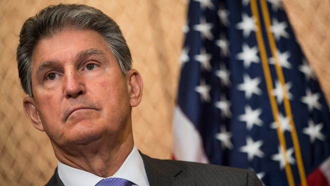 U.S. Sen. Joe Manchin, D-W.Va., looks on during a news conference on Capitol Hill June 27, 2017 in Washington, D.C.