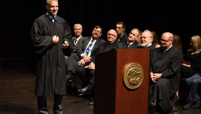 Mark E. Salter speaks after being sworn in as the 51st Justice of the South Dakota Supreme Court at an investiture celebration at the Washington Pavilion in Sioux Falls, S.D. Monday, July 9, 2018.