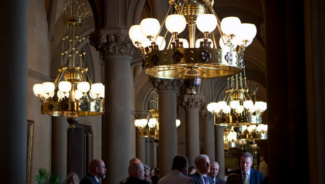 People work in the Senate lobby at the state Capitol on Wednesday, June 15, 2016, in Albany, N.Y. The Legislature is scheduled to adjourn its session this week. (AP Photo/Mike Groll)