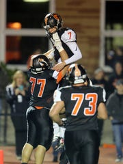 Anderson quarterback Jay Volpenhein celebrates his