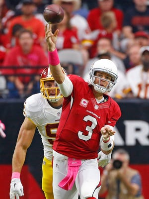 Arizona Cardinals quarterback Carson Palmer (3) throws during their NFL game against the Washington Redskins on Sunday, Oct. 12, 2014, in Glendale, Ariz.