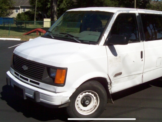 A white Chevy Astro van similar to the one police believe