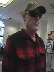 Police are searching for a suspect in the robbery of