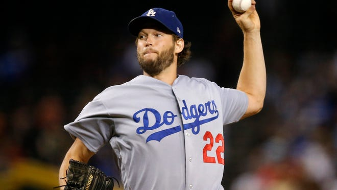 Los Angeles Dodgers starting pitcher Clayton Kershaw throws against the Arizona Diamondbacks during the first inning of a baseball game, Monday, Sept. 24, 2018, in Phoenix. (AP Photo/Ross D. Franklin)