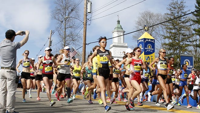 In this 2017 fiel photo, the elite women's runners head down the hill at the start of the 2017 Boston Marathon in Hopkinton on Monday, April 17, 2017.