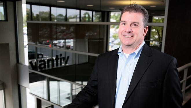 Vantiv CEO Charles Drucker poses in the company's headquarters in Symmes Township.