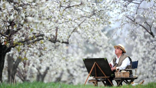 "In a 2009 file photo, Erie Artist Vitus Kaiser, then 80, paints in a cherry orchard on Dewey Road in North East Township. ""I paint almost every day,"" said Kaiser at the time. ""To be outside in glorious Erie County -- my office. I can go where I want, paint what I want, the way I want, and that is glorious."" Kaiser, 91, died Wednesday at his Erie home."