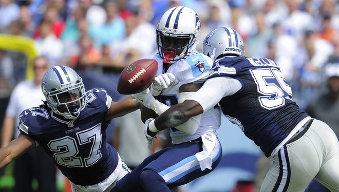 Cowboys strong safety J.J. Wilcox, left, and middle linebacker Rolando McClain break up a pass intended for Titans wide receiver Nate Washington in the first quarter.