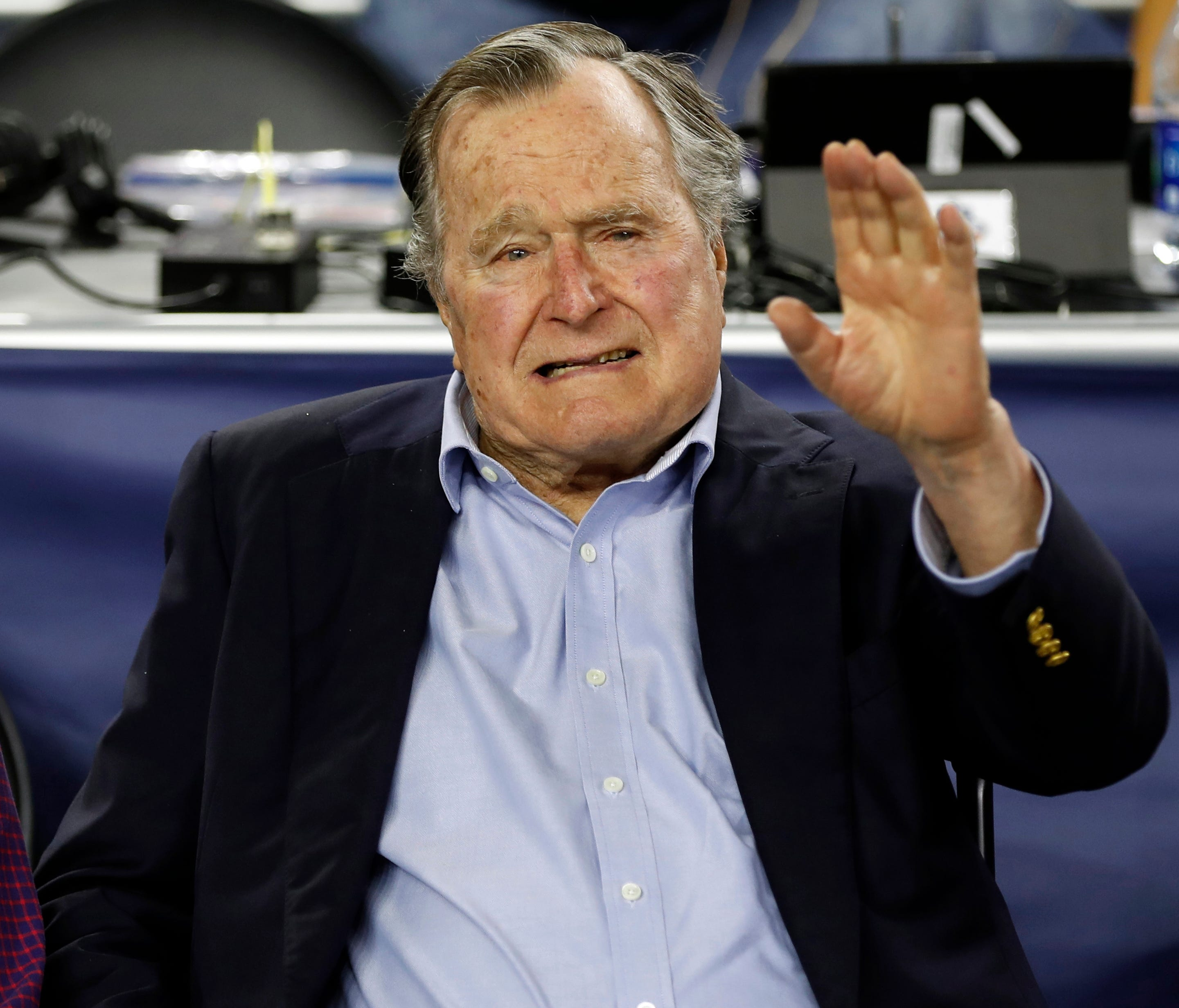 FILE - In this Saturday, April 2, 2016, file photo, former U.S. President George H. W. Bush waves as he arrives at NRG Stadium before the NCAA Final Four tournament college basketball semifinal game between Villanova and Oklahoma in Houston. Bush arr