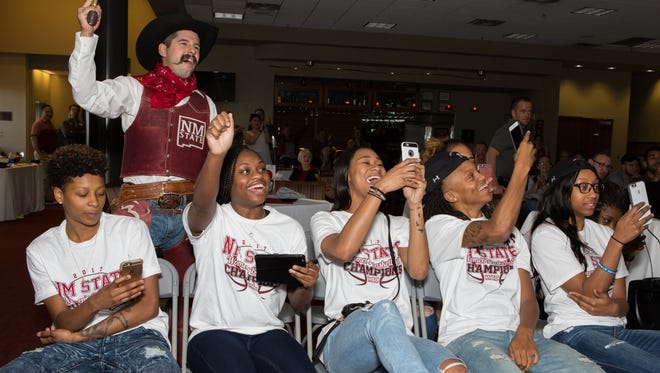 Members of the NMSU Aggie Womens basketball team, along with Pistol Pete, react upon learning of their opponent at the 2017 NCAA Bracket Watch Party held at the Sam Fulton Center on the NMSU campus on Monday.