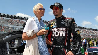 NASCAR driver Martin Truex Jr stands with his girlfriend Sherry Pollex prior to the Axalta 'We Paint Winners' 400 at Pocono Raceway in June.