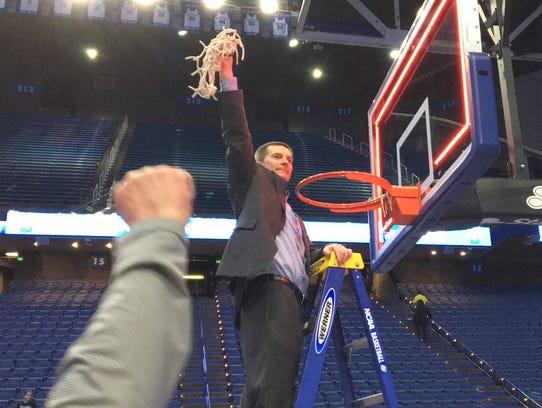 CovCath head coach Scott Ruthsatz celebrates the state