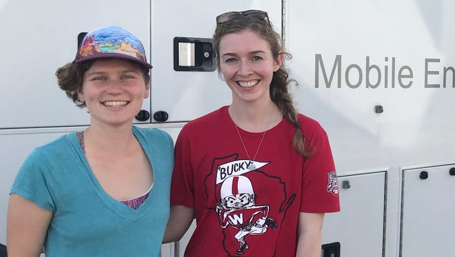 Melissa Farquhar (left) and Erin McGlynn, UW-Madison students, stand outside the Clarke mobile entomology lab, where they are working to identify mosquitoes to assist mosquito-control efforts following Hurricane Harvey.