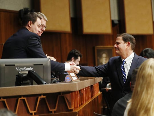 Gov. Doug Ducey (right) shakes hands with House Speaker